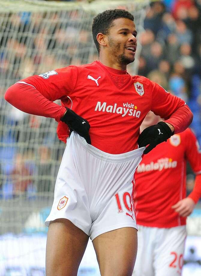 Who's got short shorts? In Bolton, England, Cardiff City's Fraizer Campbell celebrates scoring the opening goal of an English FA Cup 