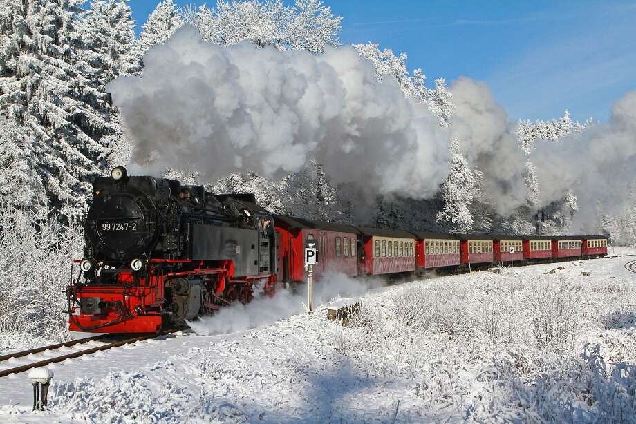 Full steam ahead! A vintage narrow-gauge train makes its way through a snowy landscape along The Brocken, the highest peak in northern Germany, near the town of 