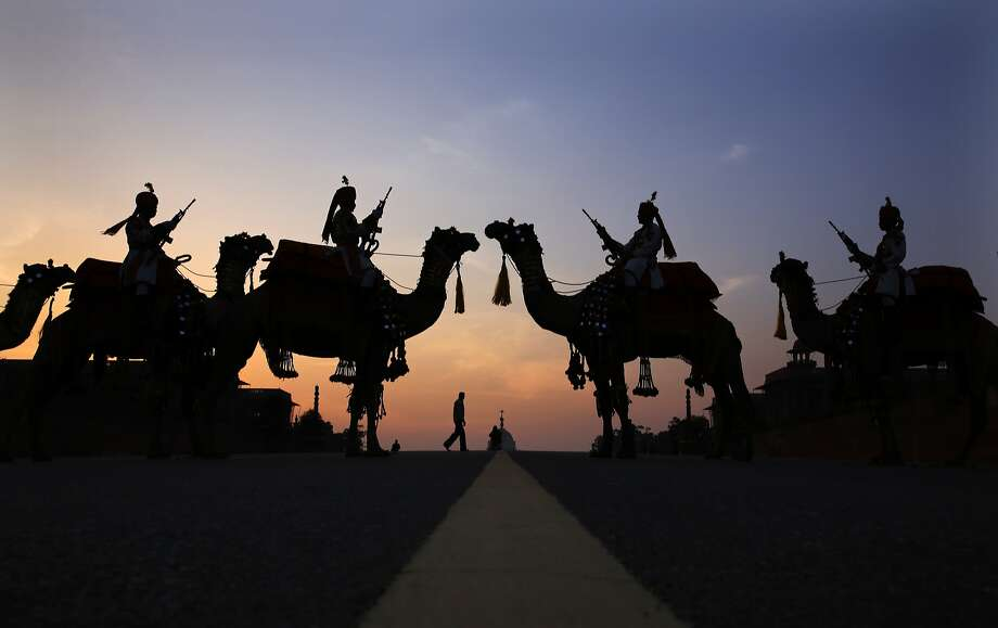 Mounted soldiersof India's Border Security Force pose their camels in a traditional symmetrical formation 