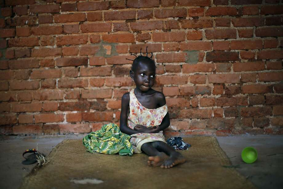 Little orphan Amandine:Seven-year-old Amandine, who cannot speak or walk, sits in the cathedral in Mbaiki, about 75 miles southwest of 