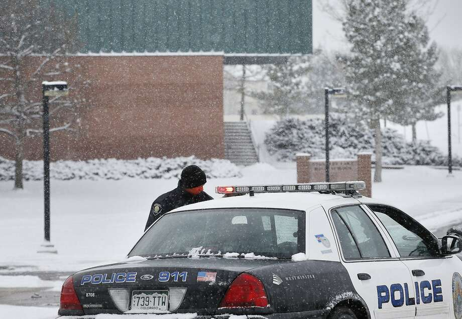 A police cruiser blocks the entrance to Standley Lake High School, where classes were canceled after an apparent suicide attempt by a student. Photo: Brennan Linsley, Associated Press