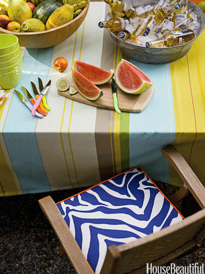 Mix and Match PatternsIn a Los Angeles bungalow, designer Moises Esquenazi mixed stripes with zebra print for a fresh modern look. Tablecloth and knives from TableArt.60+ Spring-Inspired Spaces20 Decorating Secrets No One Ever Told You7 Biggest Decorating Mistakes101 Easy Makeover Ideas32 Outdoor Room Design Ideas Photo: Reed Davis / Reed Davis