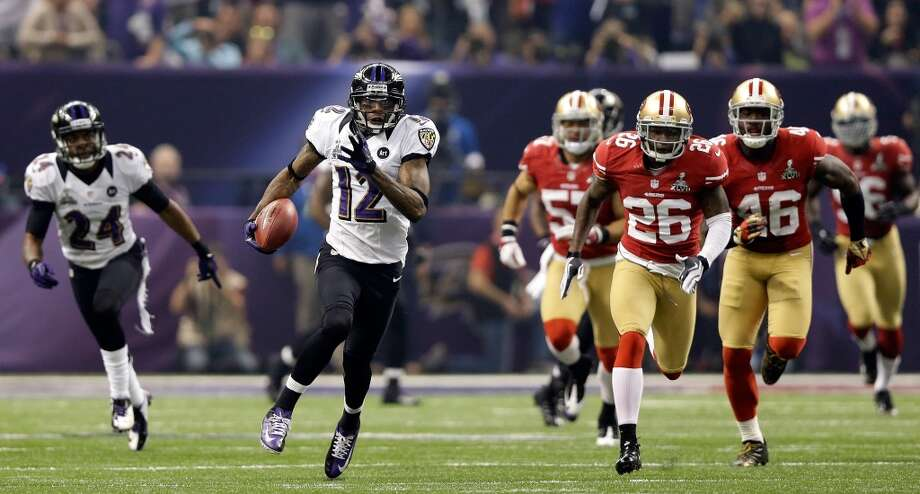 14. Super Bowl XLVII Feb. 3, 2013 Baltimore Ravens 34, San Francisco 49ers 31Jacoby Jones' 108-yard kickoff return put the Ravens up 28-6 early in the third quarter, but after a 34-minute delay due to a power outage, the 49ers staged a furious comeback. A missed two-point conversion could have tied the game with five minutes left, but the Ravens held on to send Ray Lewis into retirement with a ring. Photo: Ezra Shaw, Getty Images