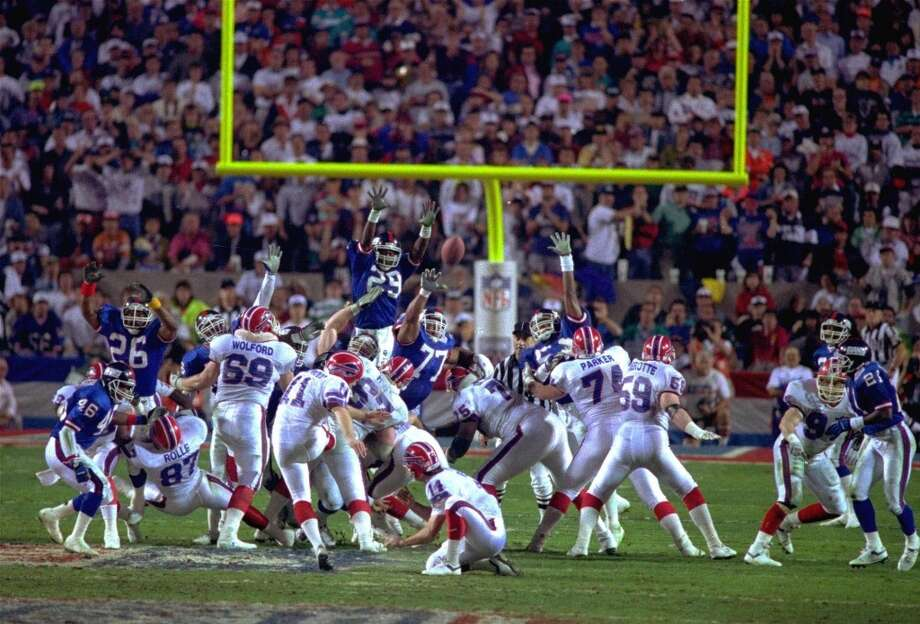 9. Super Bowl XXV Jan. 27, 1991 New York Giants 20, Buffalo Bills 19  The Bills' four-year run of futility began with a game they would have won, despite being largely throttled by the Giants' ball-control offense, if Scott Norwood hadn't been wide right on a 47-yard field goal at the end. Photo: Phil Sandlin, Associated Press