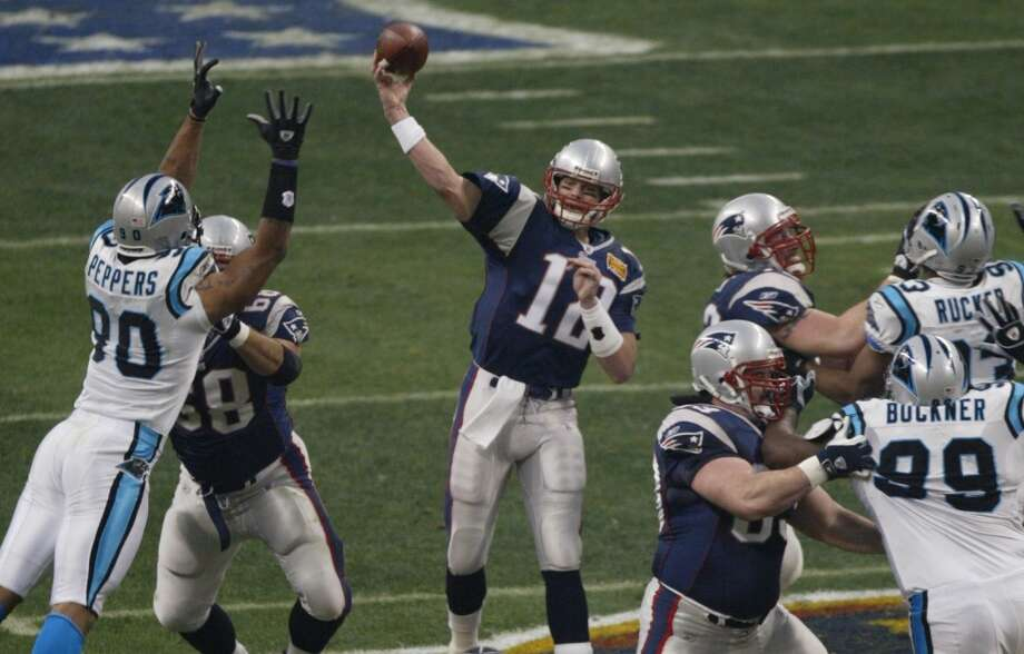 6. Super Bowl XXXVIII Feb. 1, 2004 New England Patriots 32, Carolina Panthers 29  Tom Brady and Jake Delhomme came late to what many remember as Janet Jackson's party at Reliant Stadium - it was still 0-0 after 25 minutes - but the teams went on a 24-point scoring binge in the final frantic 3:05 of the second quarter, and the game came down to another clutch Vinatieri kick with four seconds left. Photo: James Nielsen, Houston Chronicle