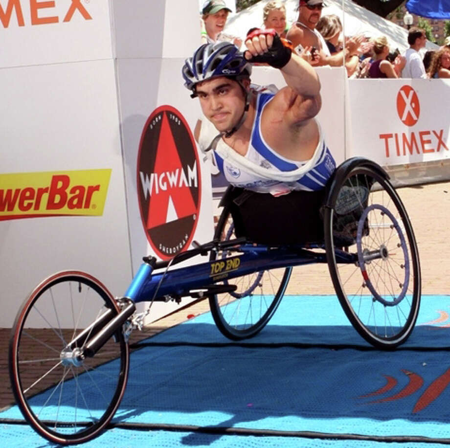 """The author of """"Triumph over Tragedy,"""" John Tartaglio races in an Iron Man Triathalon, swimming, biking and runnning. Photo: Contributed Photo / Fairfield Citizen"""