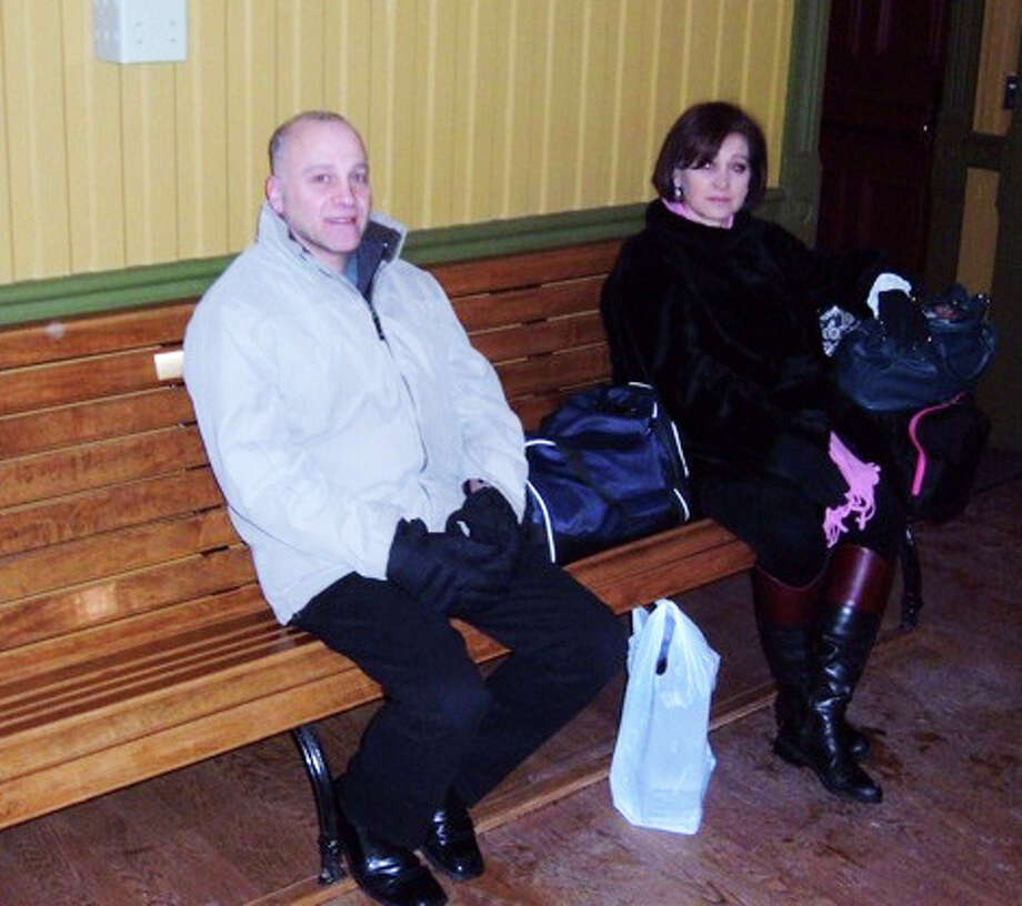 Dominick Geraci and Lina LoBello wait for the 5:56 a.m. train in the westbound Southport train depot Monday, after it was opened an hour earlier in response to commuters' requests. Photo: Andrew Brophy / Fairfield Citizen contributed