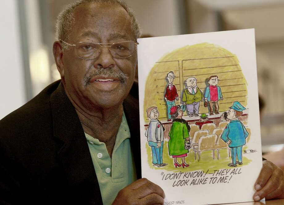 "Morrie Turner smiles at the reaction of some visitors to this cartoon he drew many years ago. Morrie Turner, the 87 year old cartoonist, who created America's first integrated strip ""Wee Pals"" is one of the artists showcased in the permanent collection of the Cartoon Art Museum. Photo: Brant Ward, The Chronicle"