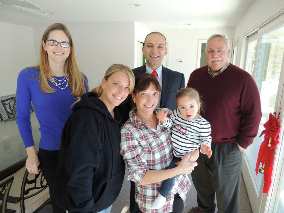 STAR Inc., Lighting the Way recently received a grant from CVS Caremark. From left, STAR special education therapist Melissa Robusto; Tricia and Marie Boccuzzo with baby Gianna Boccuzzo; Mouhamad Ayoub, manager of the CVS at 281 on Connecticut Ave., Norwalk; and Peter Saverine, development director of STAR. Photo: Contributed Photo, Contributed / New Canaan News Contributed