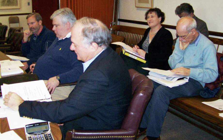 "The new ""citizen"" members of the Board of Education's Health Insurance Fund Review Committee, Charles Haberstroh and Kevin Connolly, attended their first meeting Monday afternoon in Town Hall. Pictured, from far left, are Connolly, Board of Finance member Tom Lasersohn, and Haberstroh (in the foreground). Behind them are Board of Education chairwoman Elaine Whitney and RTM member Allen Bomes. Haberstroh and Connolly are both former finance board members. Photo: Anne M. Amato / Westport News"