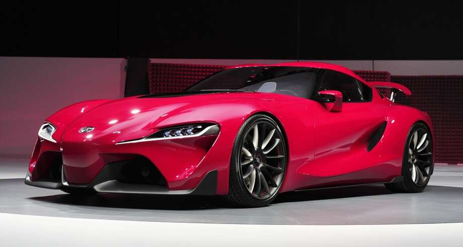 The new Toyota FT-1 Concept is revealed at the press preview of the 2014 North American International Auto Show in Detroit, Michigan. (Photo by Bill Pugliano/Getty Images) Photo: Bill Pugliano, Getty Images