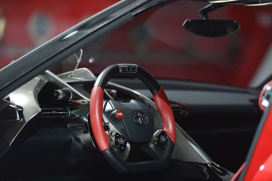The Toyota FT-1 Concept attracts attention during the 2014 North American International Auto Show in Detroit, Michigan. (Photo by Cem Ozdel/Anadolu Agency/Getty Images) Photo: Anadolu Agency, Getty Images