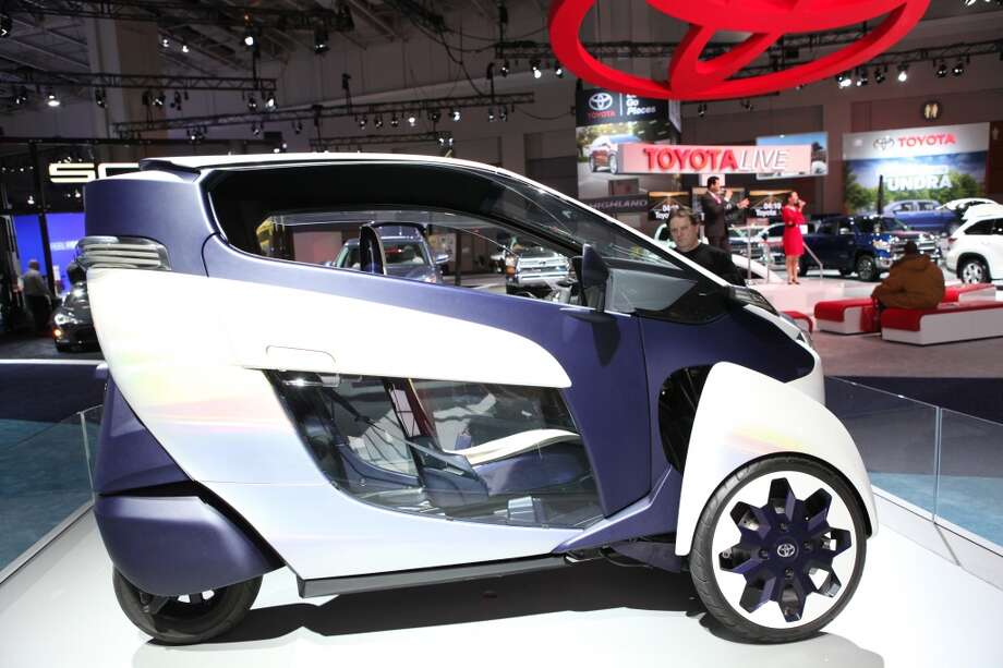 The Toyota i-Road concept is displayed during the Washington Auto Show in Washington, DC. (Photo by Basri Sahin/Anadolu Agency/Getty Images) Photo: Anadolu Agency, Getty Images