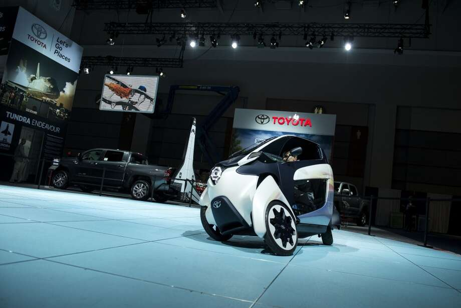 The Toyota i-Road concept is demonstrated during the Washington Auto Show in Washington, DC. (BRENDAN SMIALOWSKI/AFP/Getty Images) Photo: BRENDAN SMIALOWSKI, AFP/Getty Images