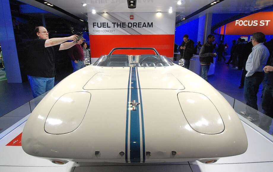 For the 50th anniversary of the Ford Mustang, Ford has on display the 1962 Ford Mustang 1 concept car which later evolved into the Mustang production car at the North American International Auto Show (NAIAS) in Detroit, Michigan.(Photo by Paul Warner/Getty Images) Photo: Paul Warner, Getty Images
