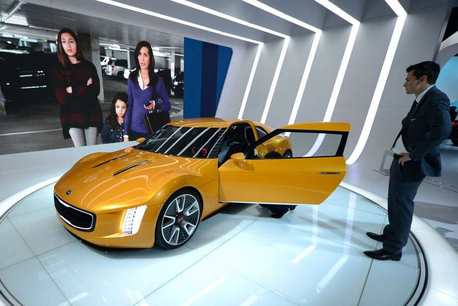 The Kia GT4 Stinger Concept attracts attention during the 2014 North American International Auto Show in Detroit, Michigan on January 14, 2014. (Photo by Cem Ozdel/Anadolu Agency/Getty Images) Photo: Anadolu Agency, Getty Images