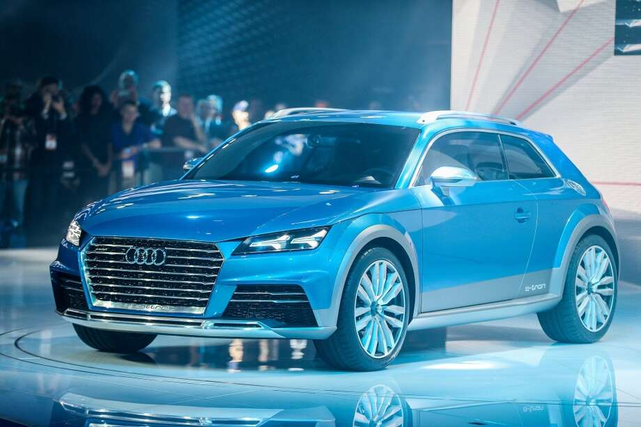 The Audi E-Tron Quattro Allroad Concept vehicle is unveiled at the 2014 North American International Auto Show in Detroit, Michigan. (GEOFF ROBINS/AFP/Getty Images) Photo: GEOFF ROBINS, AFP/Getty Images