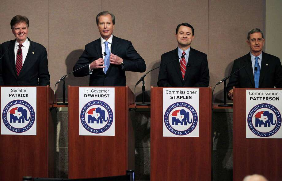 In this Dec. 12, 2013, file photo, Republican candidates, from left, state Sen. Dan Patrick, Lt. Gov. David Dewhurst, Agricultural Commissioner Todd Staples and Land Commissioner Jerry Patterson prepare for a debate at Texas State Technical College, in Waco, Texas. Staples has spent the past four years making fears of encroaching Mexican drug cartels the cornerstone of a job that's more traditionally known for keeping produce scales at grocery stores honest. Now Staples is hoping his focus on border violence distinguishes him in a crowded 2014 primary for lieutenant governor. (AP Photo/Waco Tribune Herald, Jerry Larson, File) Photo: Jerry Larson, MBO / Waco Tribune Herald