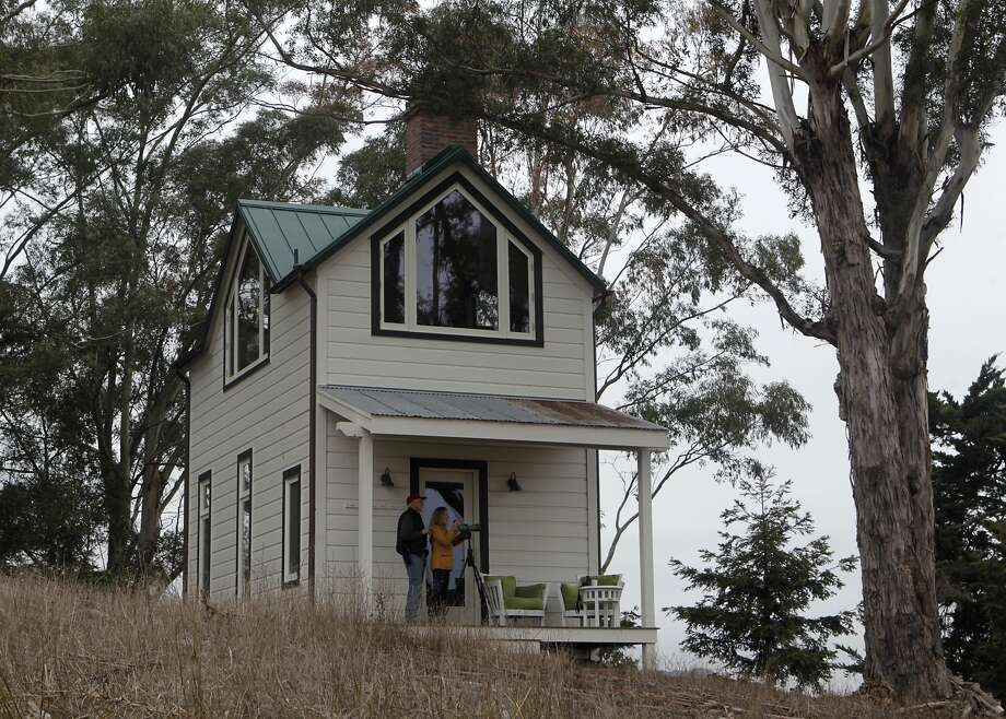 Stewart Brand (left) and Ryan Phelan observe birds from the porch of the guest cottage at their weekend home in Petaluma, which sits on 55 acres. Photo: Paul Chinn, The Chronicle
