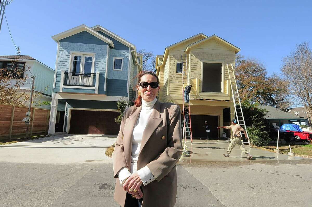 Linda Marshall of Linda Marshall Realtors Inc. sees a flurry of townhome construction in Inner Loop neighborhoods such as the Heights. Behind her is a recently completed unit at 913 Lawrence St. standing beside another under construction.