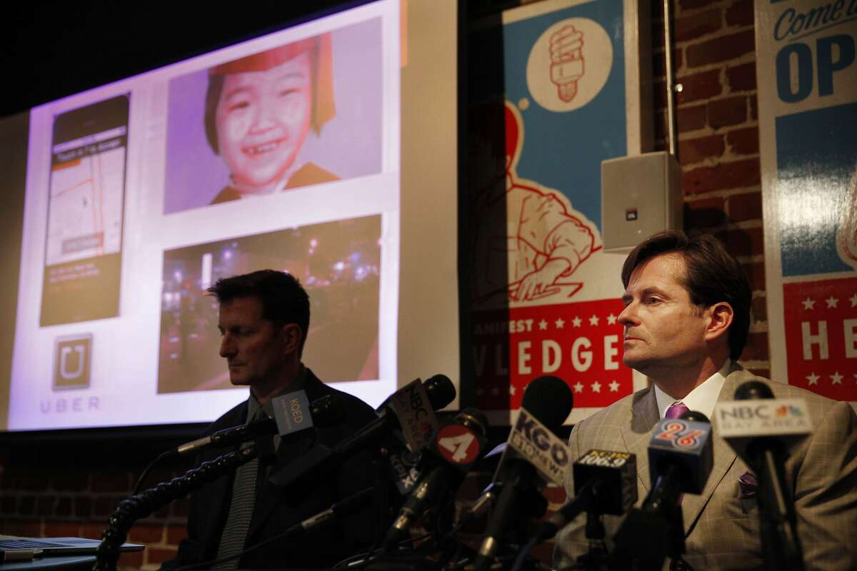 Attorney Christopher Dolan (right), who represents the family of Sofia Liu, speaks during a press conference at The Dolan Law Firm as Emile Davis (left), attorney, sits next to him on Monday, January 27, 2014 in San Francisco, Calif. 6-year-old Sofia Liu was fatally struck on New Year's Eve by a vehicle driven by Uber contractor, 57-year-old Syed Muzzafar.
