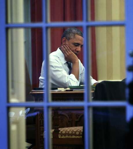Barack Obama sits in the Oval Office a day before he delivers the State of the Union address. Photo: Alex Wong / Getty Images / 2014 Getty Images