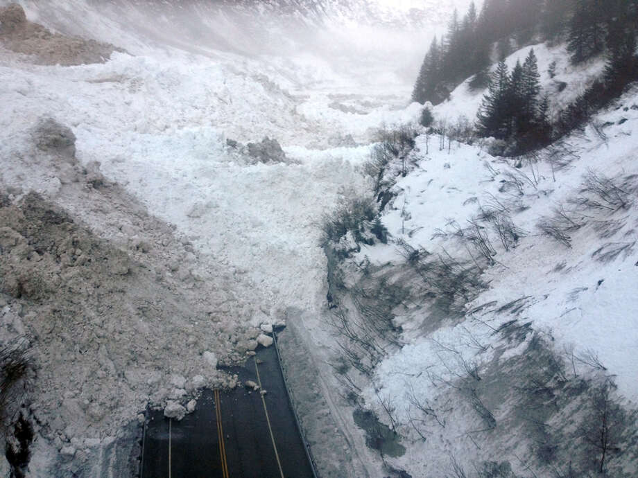 This photo shows multiple avalanches that crossed the Richardson Highway in the Thompson Pass region of Valdez, Alaska, on Jan. 24. Alaska officials say the only highway into the city will be closed for at least a week. Photo: HOPD / Alaska Department of Transportat