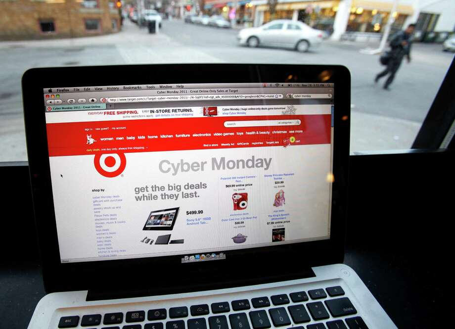 FILE - In this Monday, Nov. 28, 2011, file photo, the Target web site is photographed on a computer screen at a coffee shop in Providence, R.I.. American shoppers say they are very concerned about the safety of their personal information following a massive security breach at Target, but most aren't doing anything to ensure their data is secure, says a new Associated Press--GfK Poll released Monday, Jan. 27, 2014. (AP Photo/Michael Dwyer, File) Photo: Michael Dwyer, STF / AP