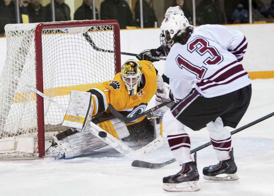 Brunswick goalie Alex Connal tries to make a save on a shot by Salisbury's Dylan Holze during a varsity boy's ice hockey game played at Hartong Rink, Greenwich, CT on Monday, January, 27th, 2014. Photo: Mark Conrad / Connecticut Post Freelance