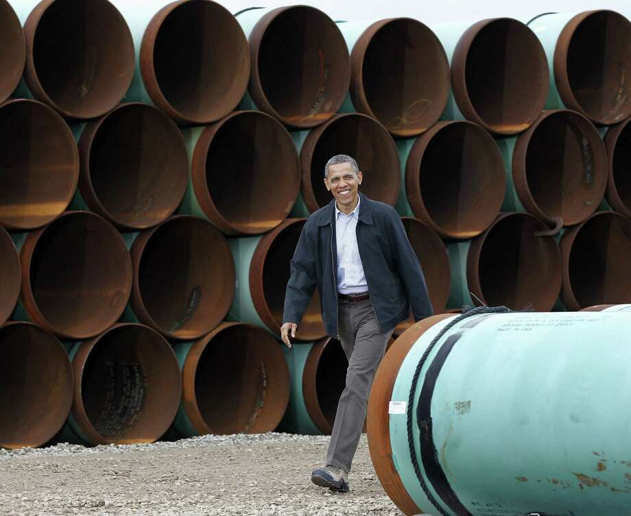 Obama arrives at the TransCanada Stillwater Pipe Yard in Cushing, Okla., in March 2012. He isn't expected to touch on the controversial Keystone XL pipeline in his speech tonight. Photo: Pablo Martinez Monsivais / Associated Press / AP
