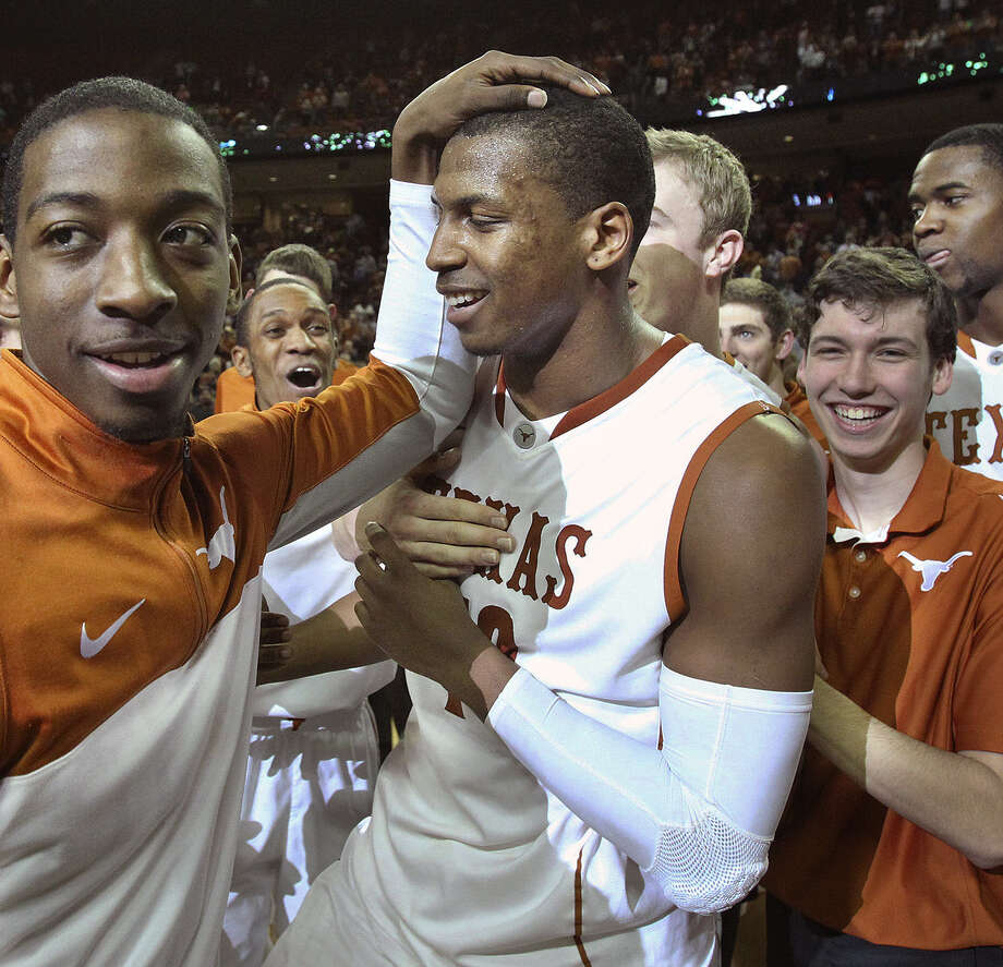 Former Antonian star Johnathan Holmes (middle) and the Longhorns, celebrating a victory over Kansas State last week, have earned the notice of pollsters with five straight victories. Photo: Tom Reel / San Antonio Express-News