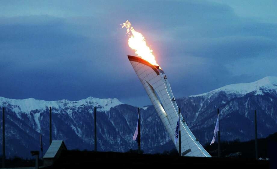 The Olympic torch gets a test burn Monday at the Olympic Park in Sochi, Russia. Photo: David J. Phillip, STF / AP