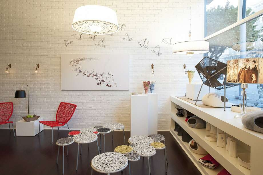BaBoo on Sacramento Street in S.F. offers home decor - its hanging Sultana lamps alone, top, are worth a visit - and fine jewelry by Tovi Farber. Photo: Lauri Levenfeld, Baboo