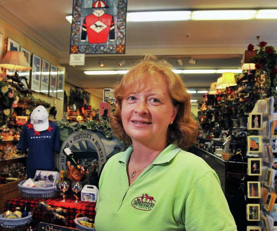 Marianne Barker, owner of Impressions of Saratoga, inside her store on Broadway in Saratoga Springs Thursday July 16, 2009.  (John Carl D'Annibale / Times Union) Photo: John Carl D'Annibale / 00004742A