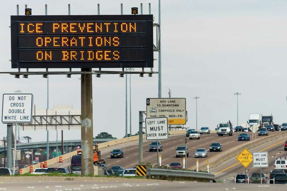 Signs on Interstate 10 just west of downtown on Monday alert drivers to preparations for the winter storm. Photo: Smiley N. Pool, Staff / © 2014  Houston Chronicle