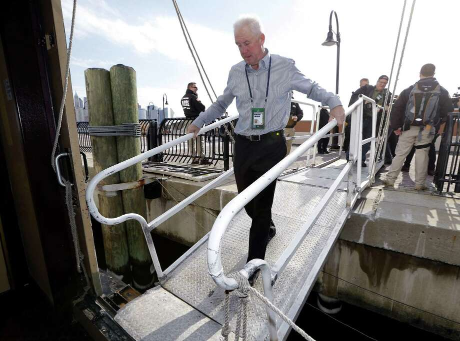Broncos coach John Fox walks down the gangway as he boards a cruise ship docked on the Hudson River, where the team's news conferences are held each day. Photo: Mark Humphrey, STF / AP