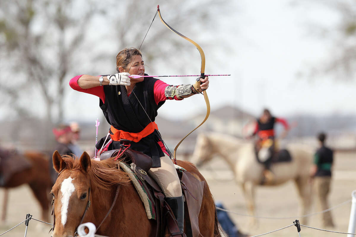 Lu Ann Groves draws on a target while atop her horse during a Mounted Archery Association of the Americas training session for the Bi-Continental Championship at 777 Three Mile Creek in New Braunfels on Saturday, Jan. 25, 2014. Photo by Marvin Pfeiffer / Prime Time Newspapers