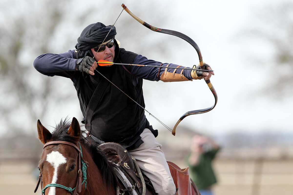 Todd Mathis draws on a target while atop his horse during a Mounted Archery Association of the Americas training session for the Bi-Continental Championship at 777 Three Mile Creek in New Braunfels on Saturday, Jan. 25, 2014. Photo by Marvin Pfeiffer / Prime Time Newspapers
