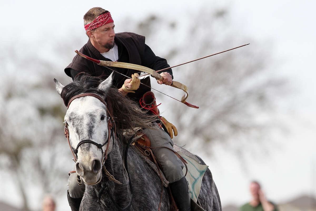 Mike Sabo knocks an arrow while atop Drako during a Mounted Archery Association of the Americas training session for the Bi-Continental Championship at 777 Three Mile Creek in New Braunfels on Saturday, Jan. 25, 2014. Photo by Marvin Pfeiffer / Prime Time Newspapers