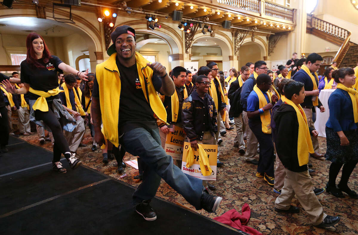 Dane White of Chicago leads students through a dance routine during the National School Choice Week Whistle- Stop Tour at Sunset Station.