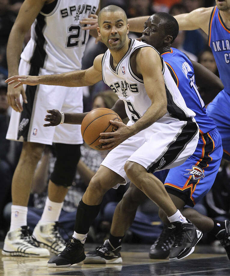 Spurs point guard Tony Parker, trying to elude the Thunder's Reggie Jackson, is a five-time All-Star whose numbers are not as impressive as some because he sees less playing time. Photo: Jerry Lara / Express-News / ©2013 San Antonio Express-News
