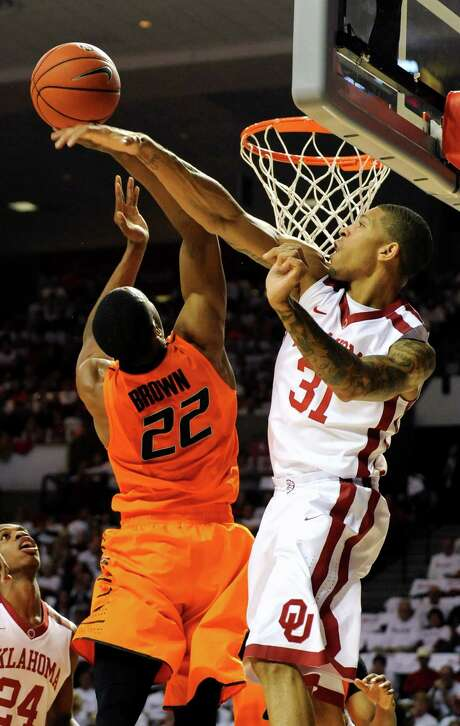 Oklahoma's D.J. Bennett, right, gives Oklahoma State guard Markel Brown a sense of rejection. Photo: Brody Schmidt, FRE / FR79308 AP