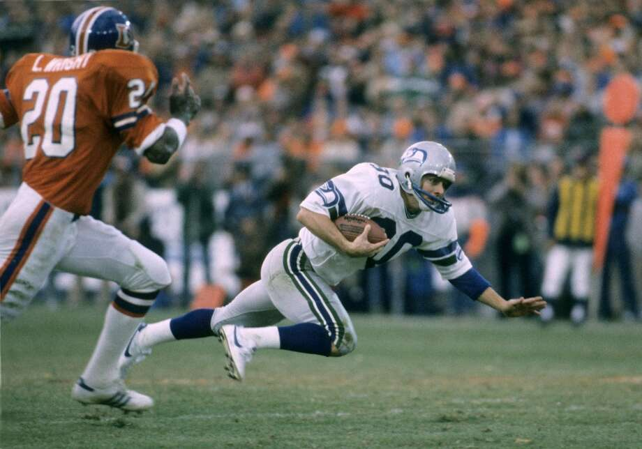 1983 AFC Wild CardThe only playoff clash to date between Seattle and Denver took place on Christmas Eve, 1983. Seattle got the best of that match-up, routing Denver 31-7 in the first postseason victory in franchise history. Offensive stars for Seattle on the day included quarterback Dave Krieg, who was ruthlessly efficient in going 12-for-13 for 200 yards and 3 touchdowns. Running back Curt Warner had 23 carries for 99 yards and Steve Largent caught 4 passes for 76 yards and a 17-yard touchdown from Krieg.Denver quarterback Steve DeBerg had been activated two days prior to the game after missing the previous nine games with a shoulder injury. He was yanked midway through the 4th quarter. His replacement? A rookie by the name of John Elway. Photo: John Betancourt, NFL