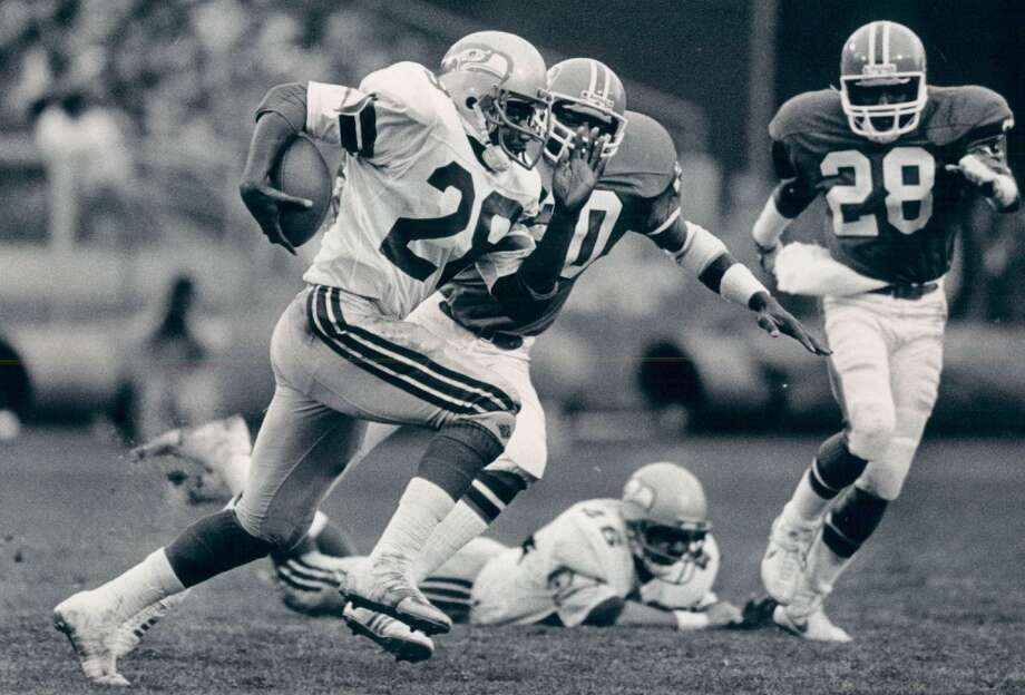 Heavyweight clashes in 1984The season following Seattle's playoff victory produced some of the highest-stakes football that the teams played during their time as division rivals. Led by coach Chuck Knox, the 1984 Hawks used excellent quarterback play from Krieg (3,671 yards passing), an elite receiver threat in Largent (74 rec. 1,164 yards) and the eventual Defensive Player of the Year in safety Kenny Easley (10 INT) to cruise to 10-2 going into the season's first match-up against Denver.The Elway-led Denver squad was an equally strong unit, taking an 11-1 record into the game against the Hawks. Seattle led 27-24 late in the fourth, but allowed the Broncos drive into position on their final drive to attempt a game-tying field goal that would have sent the game into overtime. But Denver kicker Rich Karlis knocked his attempt off the upright, giving Seattle the victory.As fate would have it, the teams would meet again in the last game of the season with identical 12-3 records and the winner taking the AFC West. This game was less of a nail-biter, as the Broncos dominated from start to finish, notching a 31-14 victory and a division title. Photo: Eric Bakke, Denver Post Via Getty Images