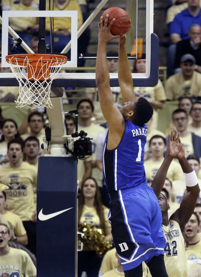 Duke's Jabari Parker (1) goes over Pittsburgh's Talib Zanna (42) for a dunk during the first half of an NCAA college basketball game on Monday, Jan. 27, 2014, in Pittsburgh. (AP Photo/Keith Srakocic) ORG XMIT: PAKS103 Photo: Keith Srakocic / AP