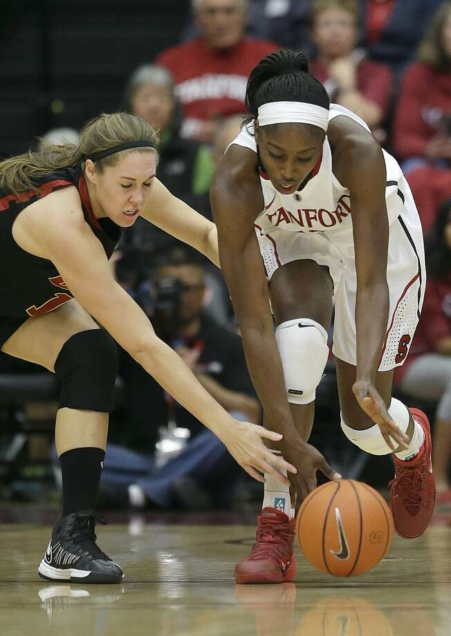 Stanford forward Chiney Ogwumike, right, reaches for a loose ball in front of USC forward Cassie Harberts during the first half of an NCAA college basketball game in Stanford, Calif., Monday, Jan. 27, 2014. (AP Photo/Jeff Chiu) Photo: Jeff Chiu, Associated Press