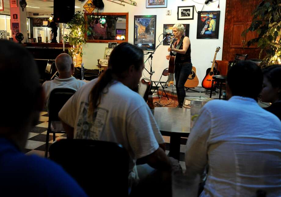 Audiences watch as a member of the Puente band performs a solo at the Logon Cafe in Beaumont, Thursday, July 19, 2012. Tammy McKinley/The Beaumont Enterprise