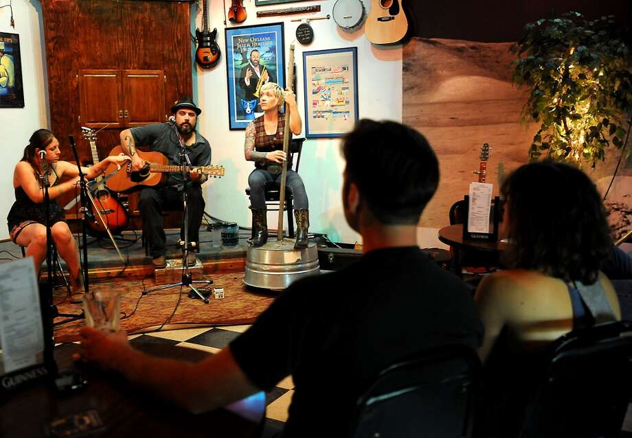 The audience watches as Puente performs at the Logon Cafe in Beaumont, Thursday, July 19, 2012. Tammy McKinley/The Beaumont Enterprise