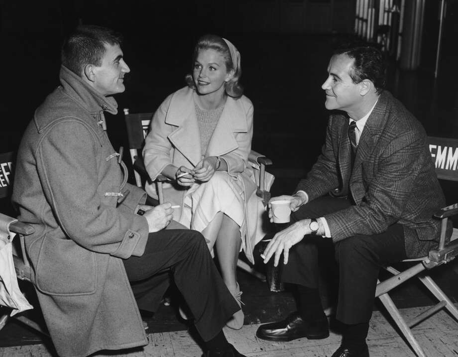 On the 1962 set of 'Days of Wine and Roses,' on location at the Place Pigalle restaurant in San Francisco, American director Blake Edwards, American actor Lee Remick (L-R) and American actor Jack Lemmon discuss a scene as they sit in canvas director's chairs and smoke cigarettes. (Photo by KMR Publications/Getty Images) Photo: KMR Publications, Getty Images