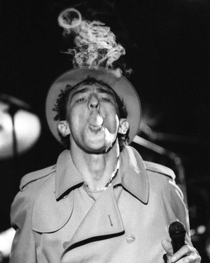 "Performers used to get in on the smoking action too. Fee Waybill of The Tubes performs the song ""Smoke"" at the Old Waldorf in San Francisco on Feb. 1, 1982. (Photo by Clayton Call/Redferns) Photo: Clayton Call, Redferns"